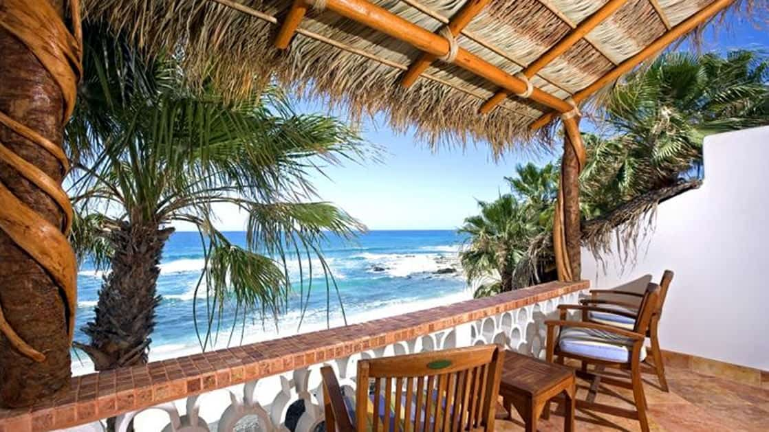At the Cabo Surf Hotel and Spa in Los Cabos, Baja, guests can sit on chairs on a shaded balcony with a thatched roof to hear the soothing sound of waves crashing in the ocean