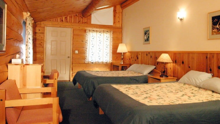 One of the guest cabins at Kantishna Roadhouse decorated with Alaskan charm and style. The rooms are built from White spruce logs. It is furnished with two beds and down comforters.