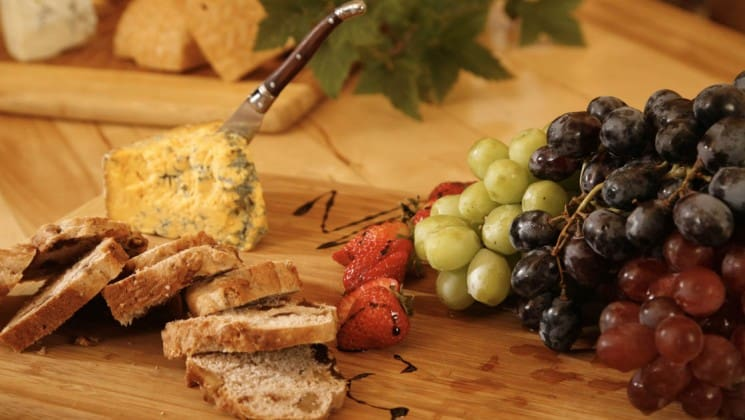 A spread of cheese, crackers, and grapes at the Tutka Bay Wilderness Lodge in Alaska