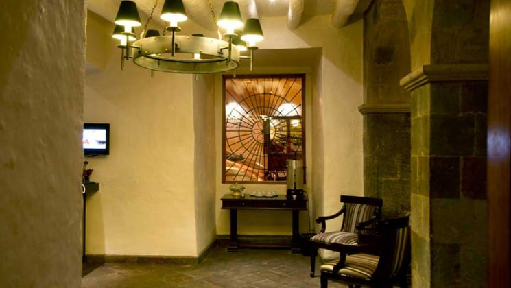 Lobby of Costa del Sol Cusco in Peru, with seating area, coffee station and window to street