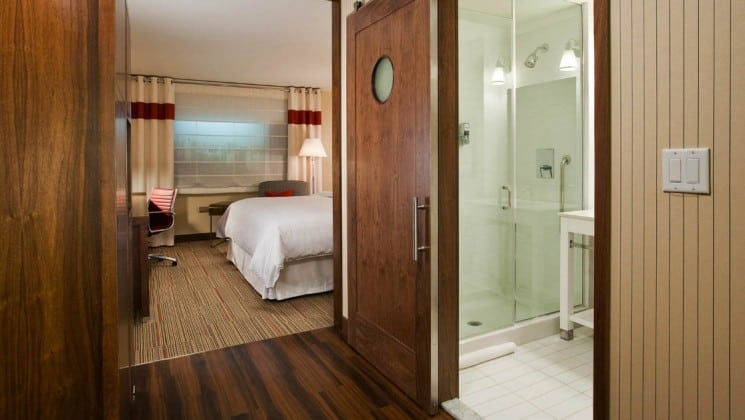 Glass shower in bathroom separated from main room by barn door at Four Points by Sheraton in Juneau, Alaska
