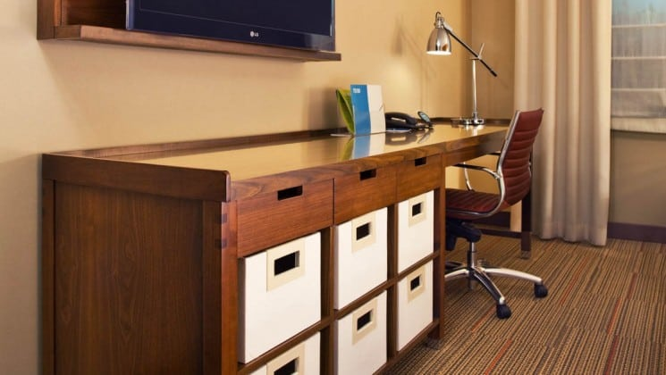 Desk with drawers, chair, lamp, TV in room at Four Points by Sheraton in Juneau, Alaska