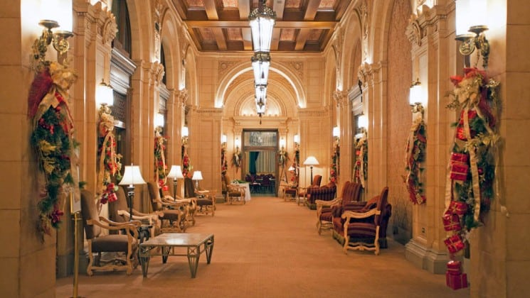 Walkway with holiday decorations and sitting areas at Fort Garry Hotel in Winnipeg