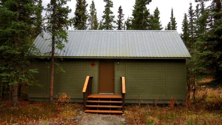 Front of guest cabin surrounded by trees at Denali Education Center near Alaska's Denali National Park