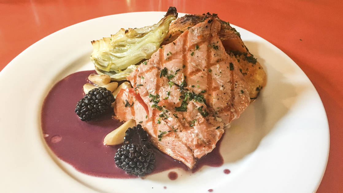 Fresh cooked Alaskan Salmon with blueberry sauce served aboard Ursus.