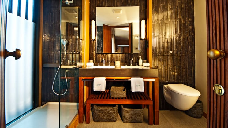 Aqua Mekong Design Suite Bathroom with large sink area, toilet and shower.