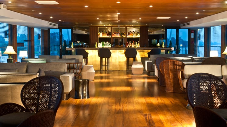 Aqua Mekong Indoor Lounge with couches, coffee tables and bar.