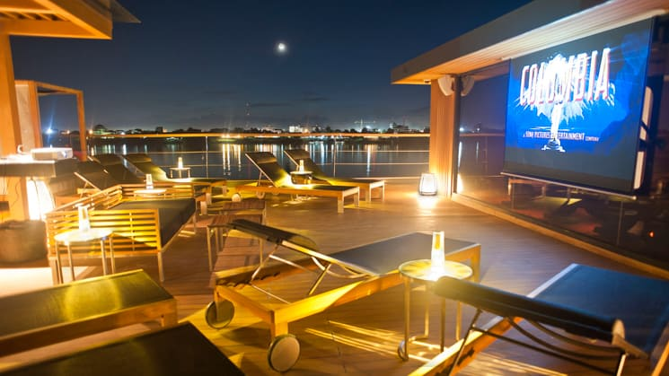 Aqua Mekong Outdoor Cinema with large screen, chaise lounges on the top deck.