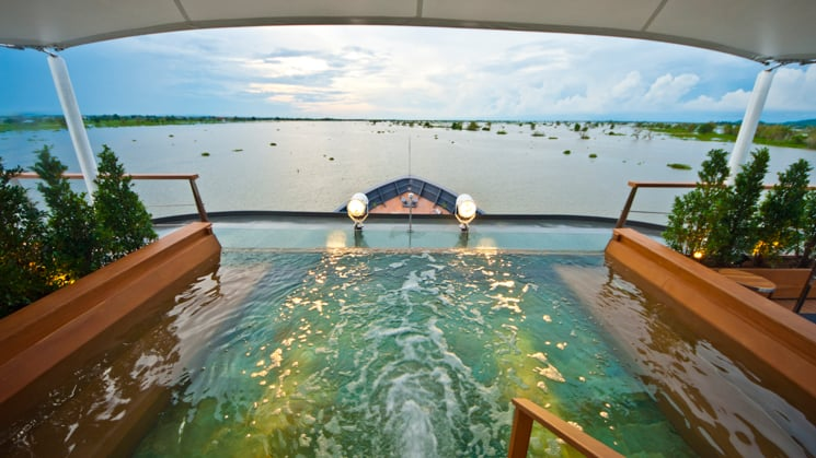 Aqua Mekong Outdoor Top Deck Plunge Pool with a view of bow and river.