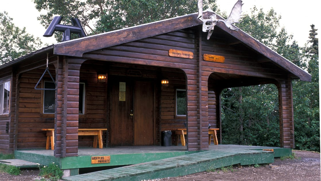 The Brooks Lodge, a charming and old log building, is one of the best access points for watching brown bears fish for sockeye salmon in Katmai National Park.