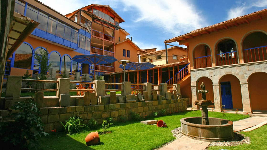 The courtyard with a lawn and a fountain at the Casa Andina Classic Cusco San Blas, located in historic Cusco, Peru, just three blocks off the main plaza.