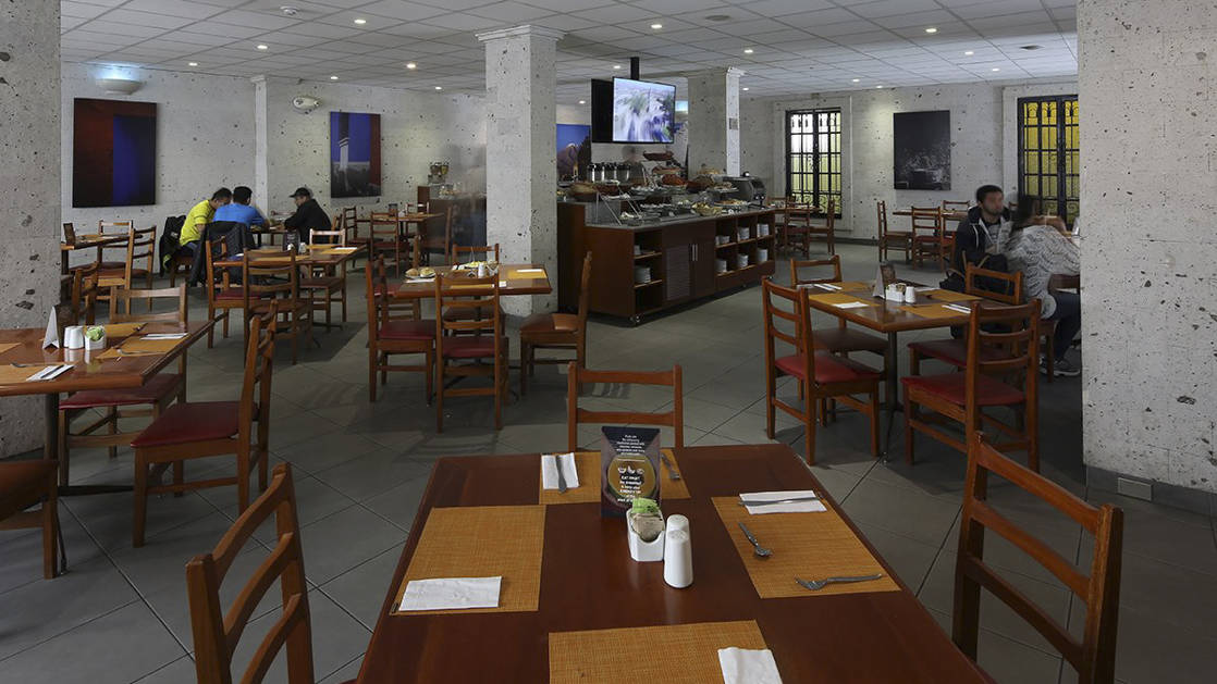 Tables and chairs are set at the Sama Restaurante Café, offering Peruvian and international fusion cuisine for breakfast, lunch and dinner at the Casa Andina Standard Arequipa in Peru.