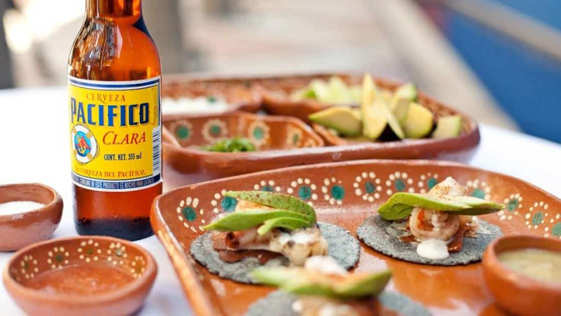 A bottle of Pacifico beer and fresh ceviche appetizers topped with avocado at Casa Natalia boutique hotel in San Jose del Cabo on the Baja Peninsula