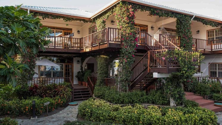 Walkways and balconies surrounded by vibrant local foliage at Chabil Mar Villas in Belize