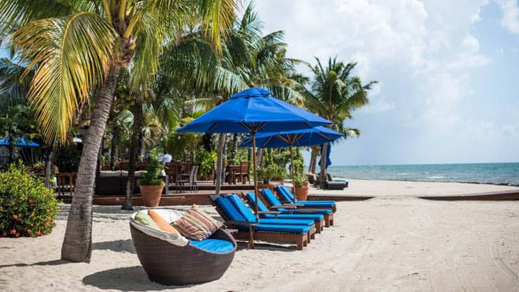 Beachfront chaise loungers with unobstructed ocean views at Chabil Mar Villas in Belize
