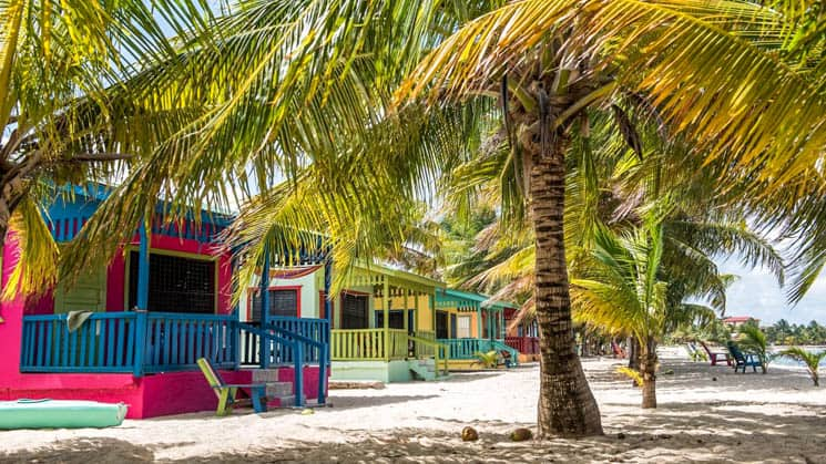Distinctly colored beachside villas just steps from the sand at Chabil Mar Villas in Belize