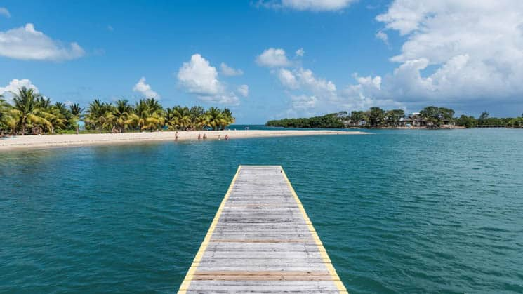The end of the dock offers amazing panoramic views of ocean and sky at Chabil Mar Villas in Belize