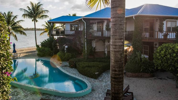 Seaside pool with beach and ocean views at Chabil Mar Villas in Belize