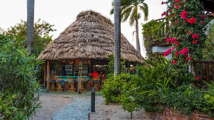 Tiki bar with thatched roof at Chabil Mar Villas in Belize