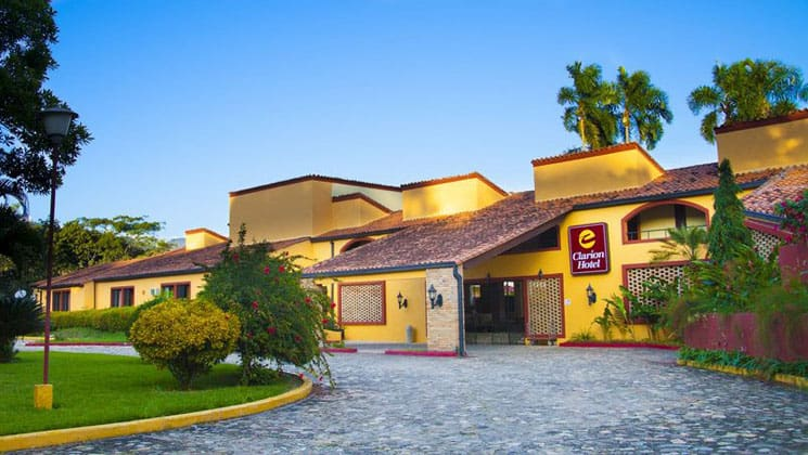 Exterior of Clarion Hotel Copan Ruinas, at the foot of a lush mountain in western Honduras