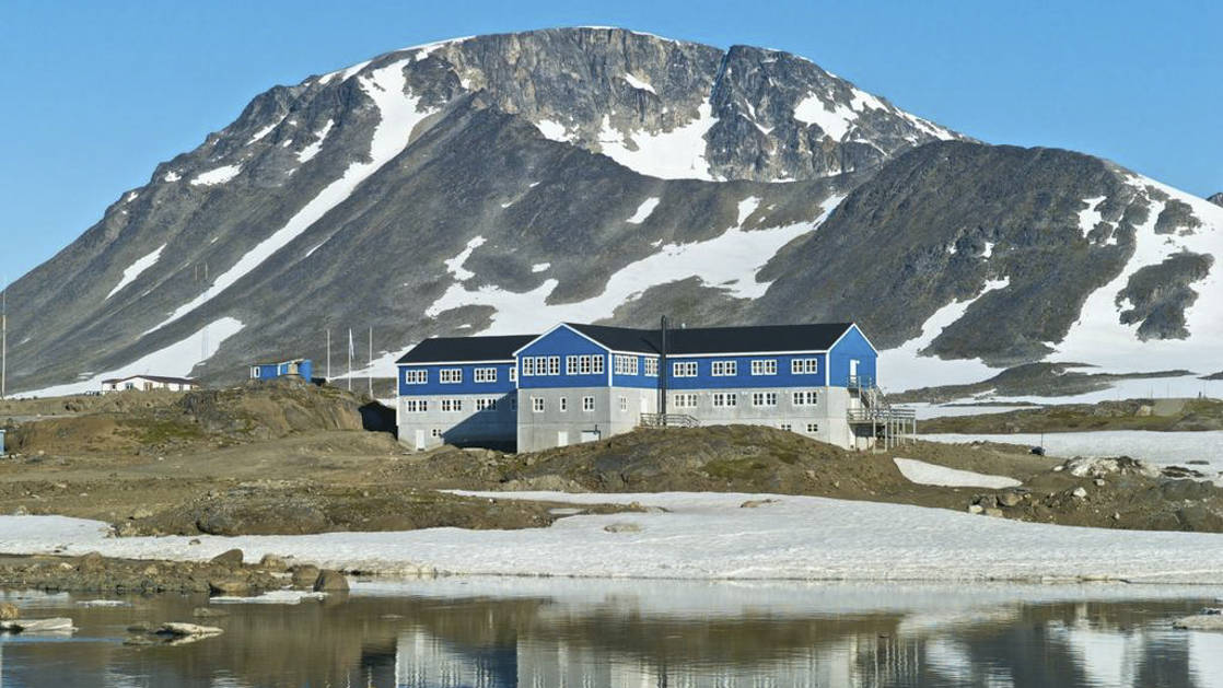 The exterior of Hotel Kulusuk, a remote yet comfortable lodge with a unique vantage point between Apusiaajik Glacier and Isikajia Mountain in Greenland
