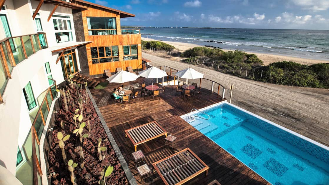 The view from the Iguana Crossing Boutique Hotel overlooks the pool, beach, and ocean on Isabela Island in the Galapagos Islands.