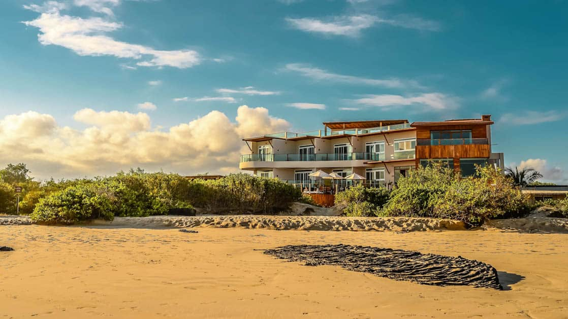 The sustainable resort Iguana Crossing Boutique Hotel sits on the beachfront in Puerto Villamil on Isabela Island in the Galapagos Islands.