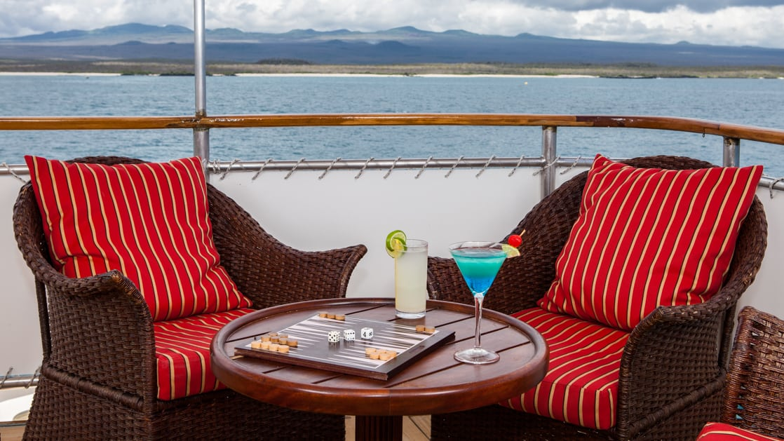 2 cushioned chairs on the deck of the Grace.