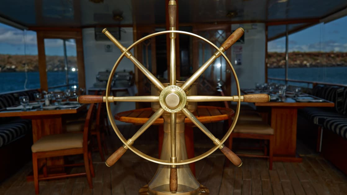 The ships wheel on the back deck of the Grace.