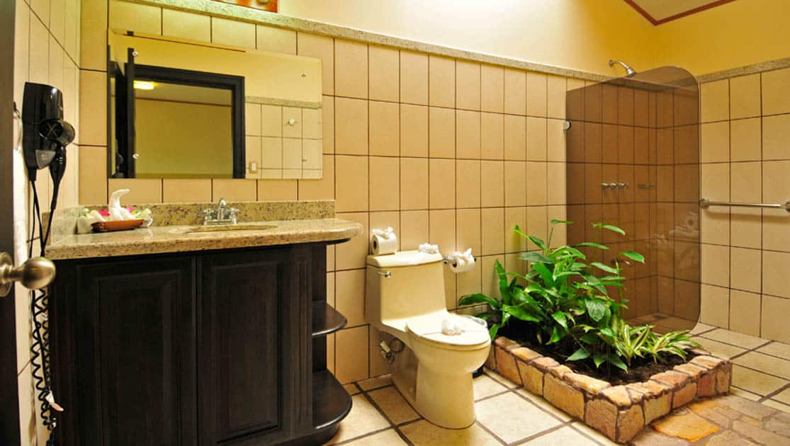 The tiled bathrooms are decorated with plants at the sustainable Arenal Manoa Lodge in Costa Rica