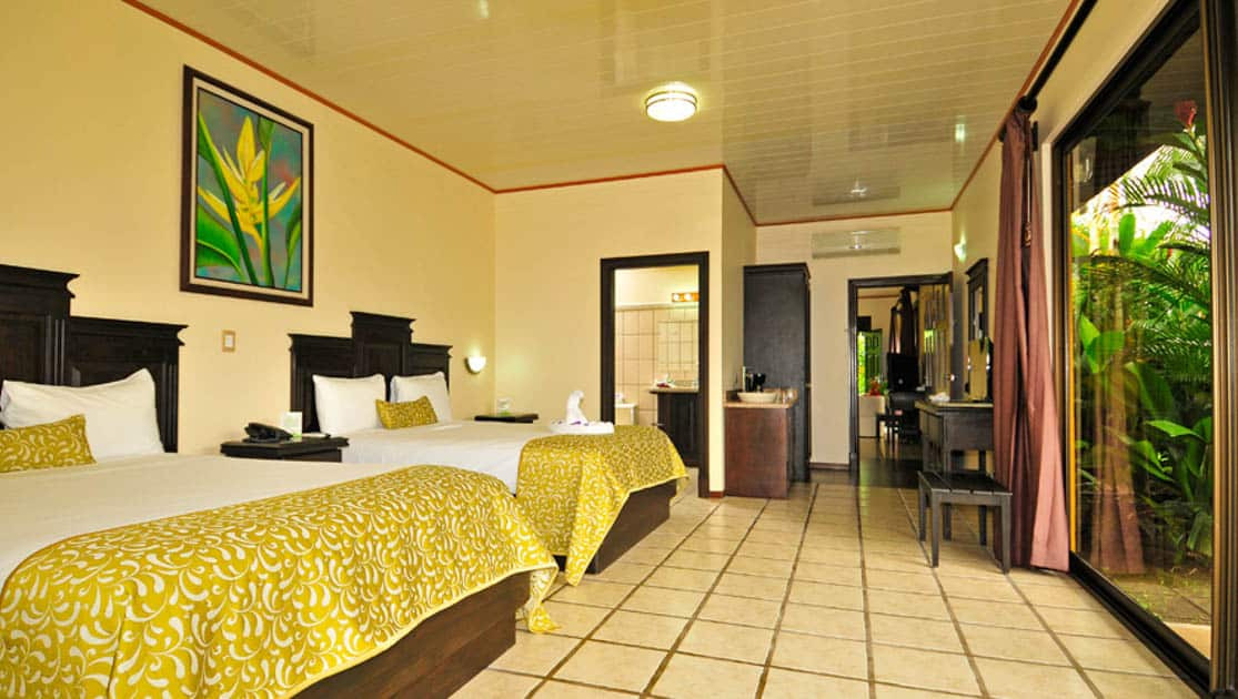 With a bright, clean room, two queen beds, tiled floors, artwork, and a view of the jungle, the Arenal Manoa Lodge in Costa Rica is perfect for naturalists