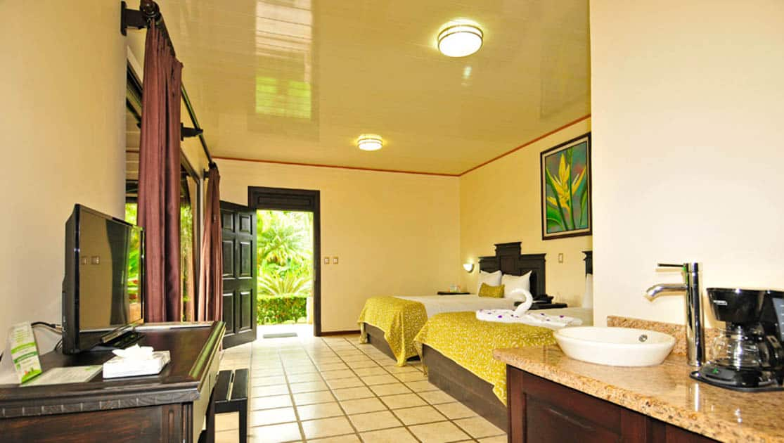 The vanity, coffee maker, and television make a stay in the junior suite at the Arenal Manoa Lodge comfortable
