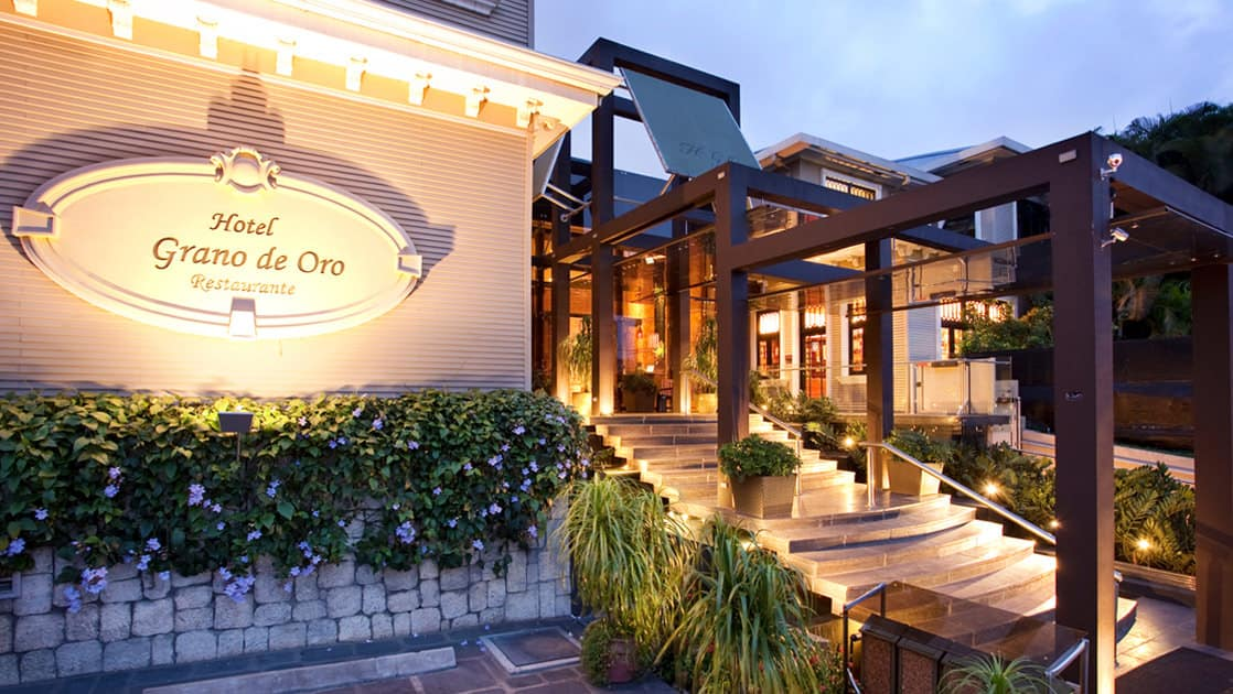 The entrance to Hotel Grano de Oro in San Jose, Costa Rica, is a renovated, elegant, Victorian mansion with steps and landscaping.