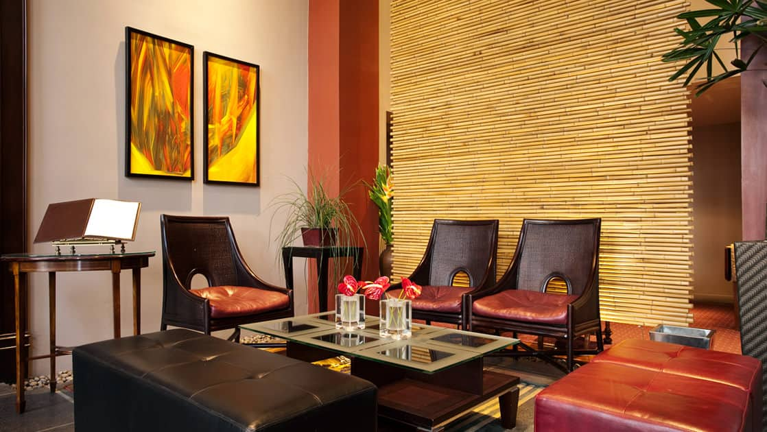 Chairs are situated around a table in the lobby of the Grano de Oro, a boutique hotel in San Jose, Costa Rica
