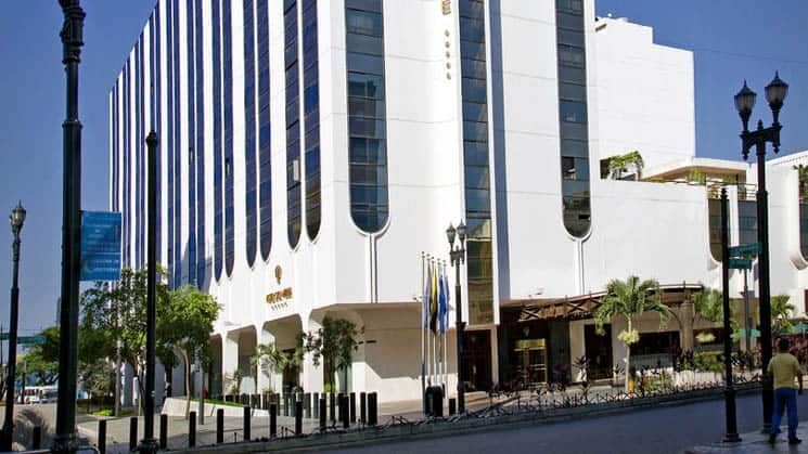 The exterior of the white, high-rise building that is the Hotel Oro Verde, located in downtown Guayaquil, Ecuador
