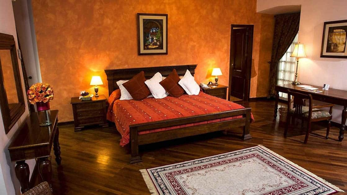A room at the colonial-era Hotel Patio Andaluz in Quito, Ecuador, has an extra large double bed