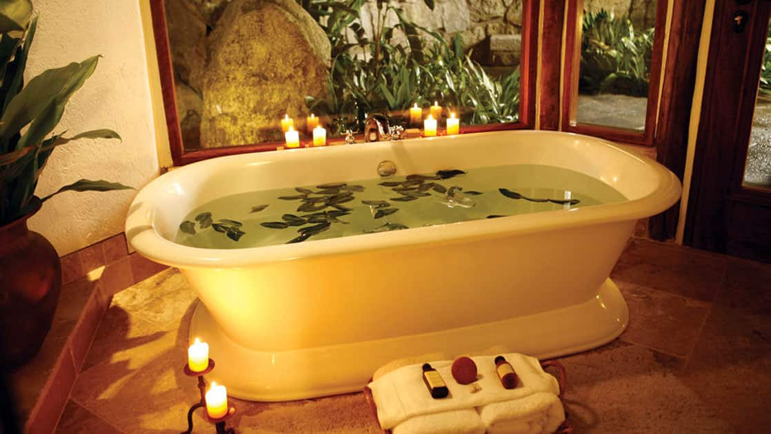 A bath is drawn at the Inkaterra Machu Picchu Pueblo Hotel, with warm light and water steemed with local botanical extracts (mint, eucalyptus and orchids).