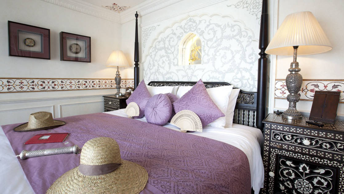 Jahan Suite with queen bed, nightstands and reading lights.