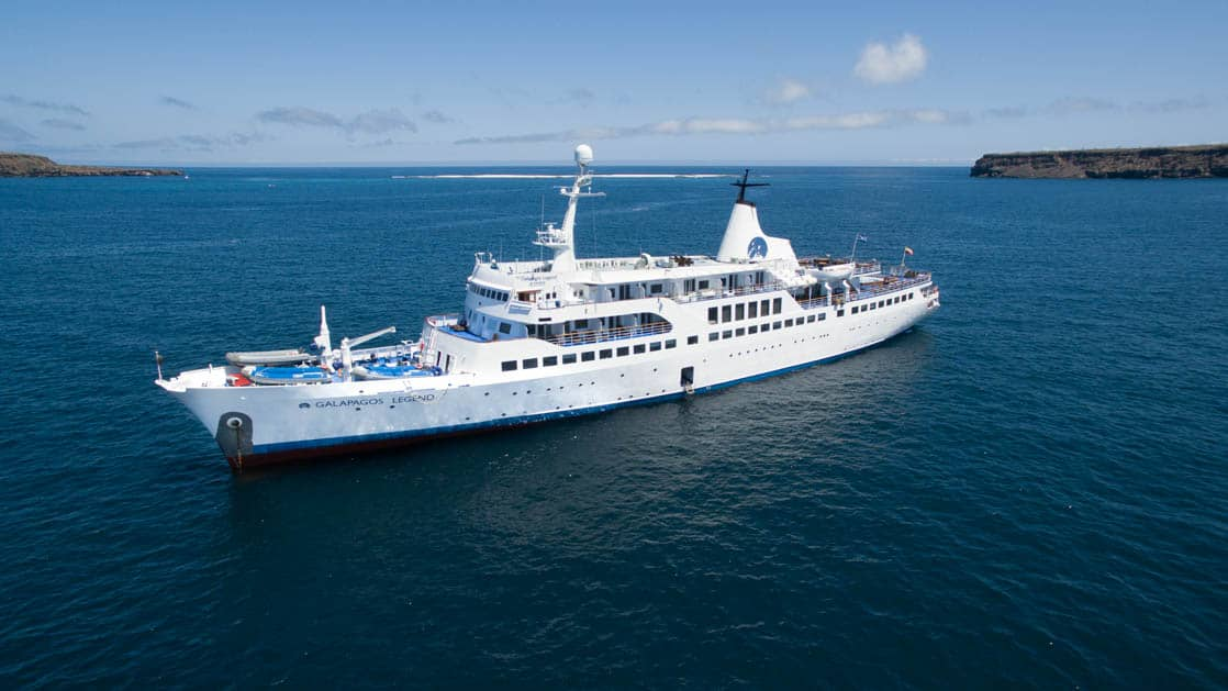 Galapagos Legend ship sailing on blue water photographed from above