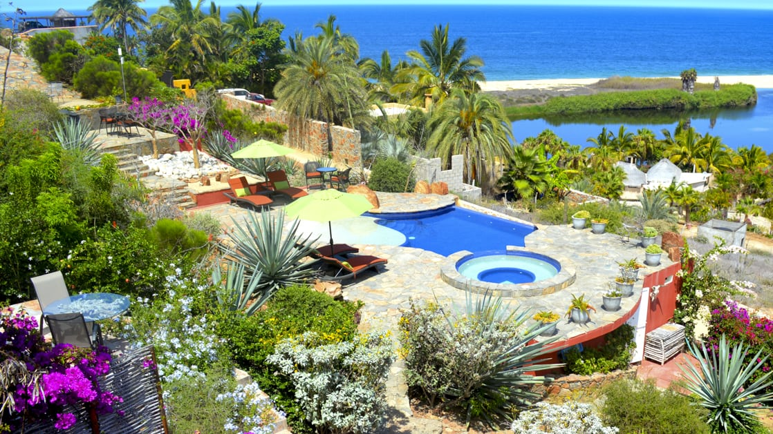 The boutique Baja hotel Los Colibris Casitas is has a deep connection to the local environment with desert vibes, pools, vegetation and views of the ocean