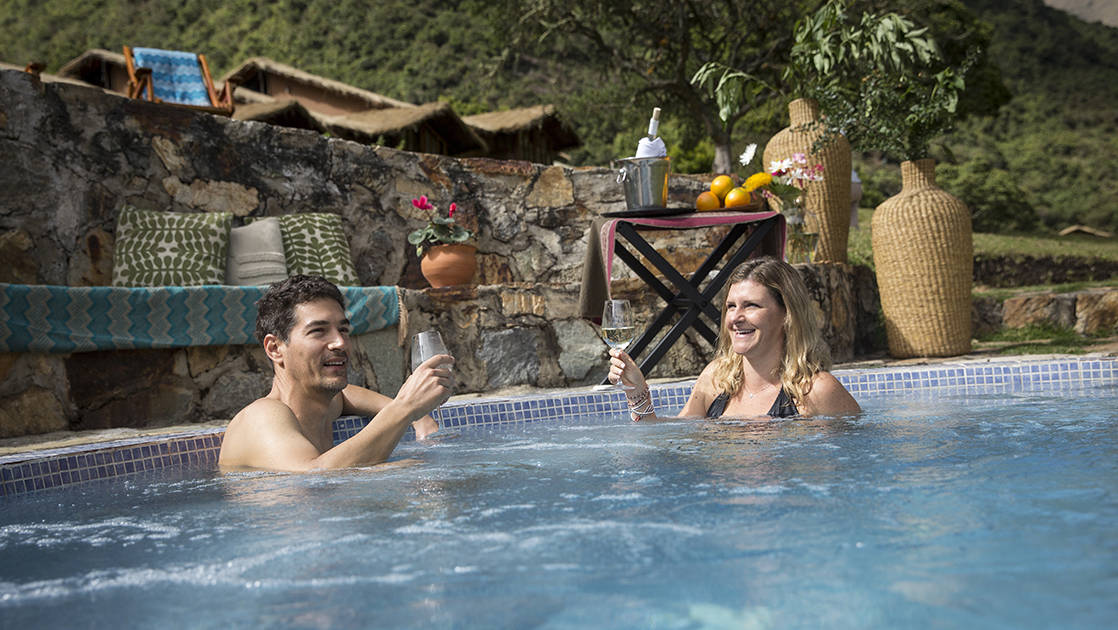 Two people soak in one of the natural hot springs at the Colpa Lodge, part of the Mountain Lodges of Peru on the Inca Trail to Machu Picchu