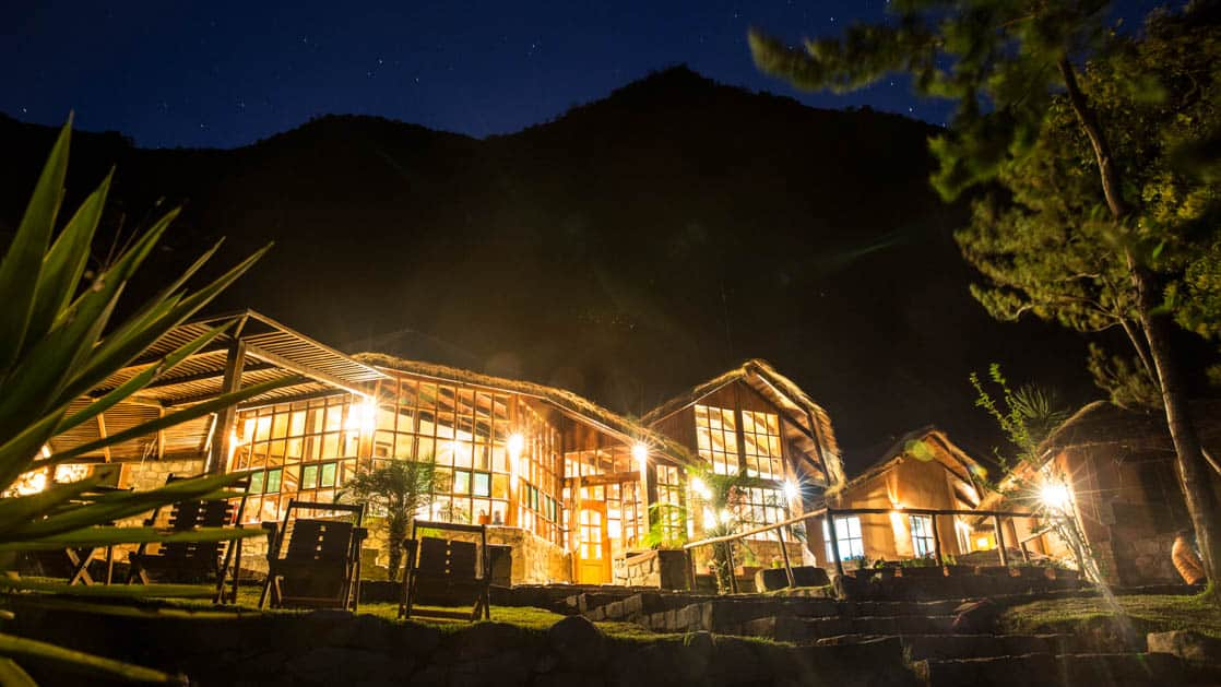 At nights, lights glow from inside the Lucma Lodge, built into the mountainside and adjacent to an avocado farm. It is one of the mountain lodges of Peru along the inca trail to Machu Picchu