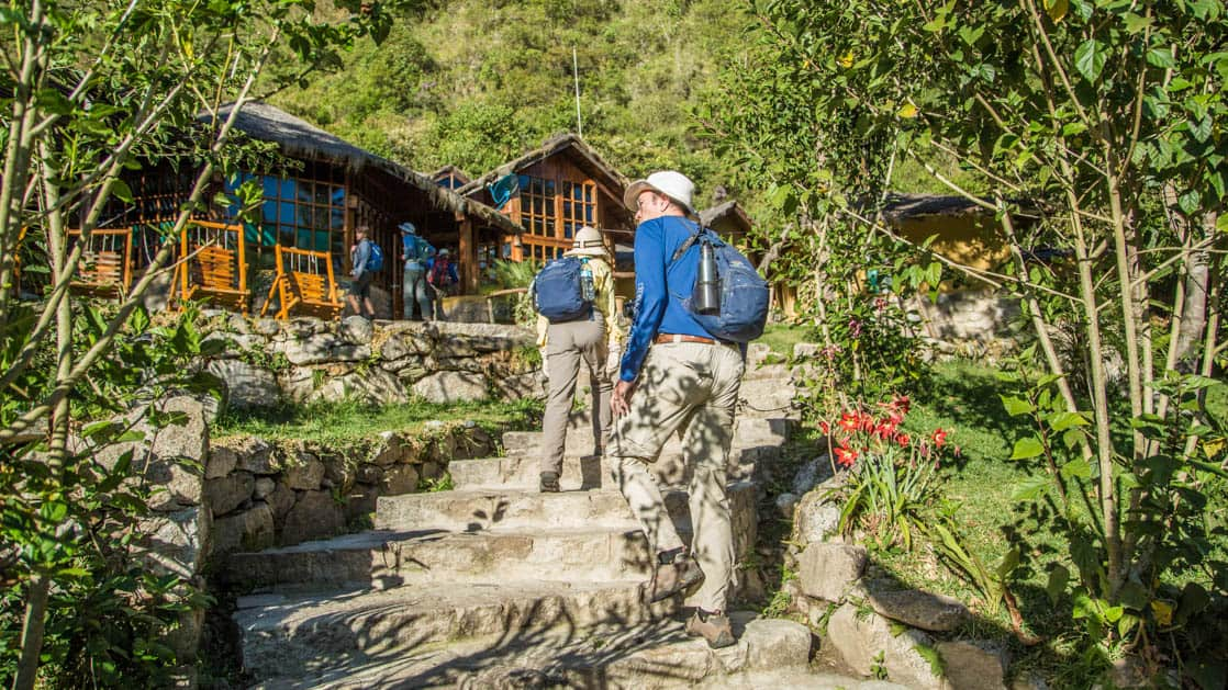 Guests walk up a pathway toward the Lucma Lodge in Peru, located along the Inca trail to Machu Picchu