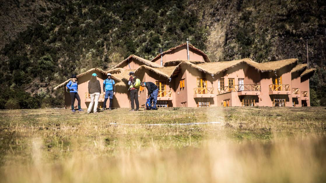 A group of trekkers stand outside the Salkantay Lodge and Adventure Resort, one of four hotels that are part of the Mountain Lodges of Peru on the Inca Trail to Machu Picchu