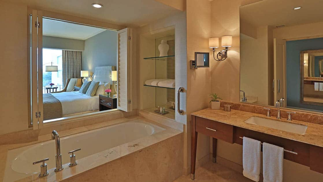 The bathroom in the Tower Executive Room with a large bathtub and modern vanity at the Bristol Panama Hotel
