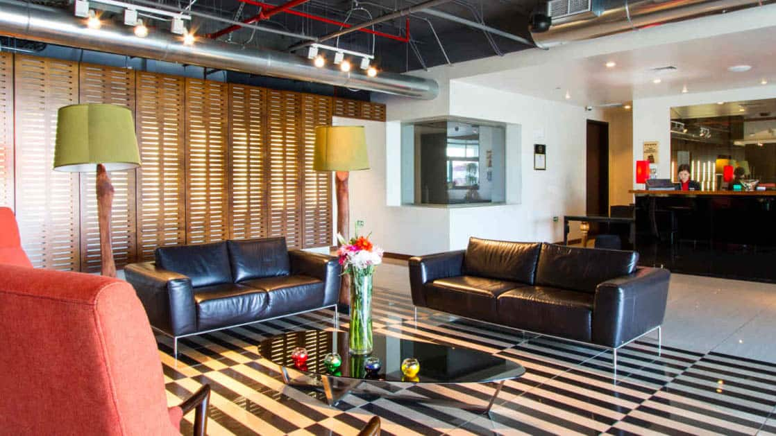With a couch, reading lamps, and modern accent furniture, the lobby greets guests at the Park Inn by Radisson, located in San Jose, Costa Rica