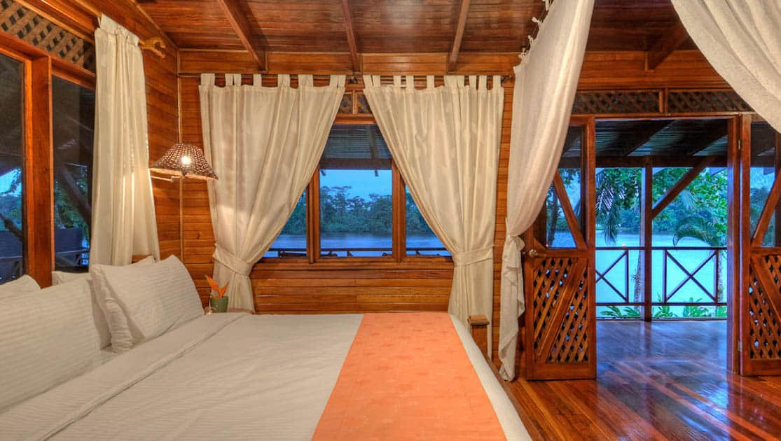The River View Penthouse Suite with a king-sized bed and a river-facing front porch with hammocks and rocking chairs, at the Tortuga Lodge, one of Costa Rica's most environmentally conscious accommodations.