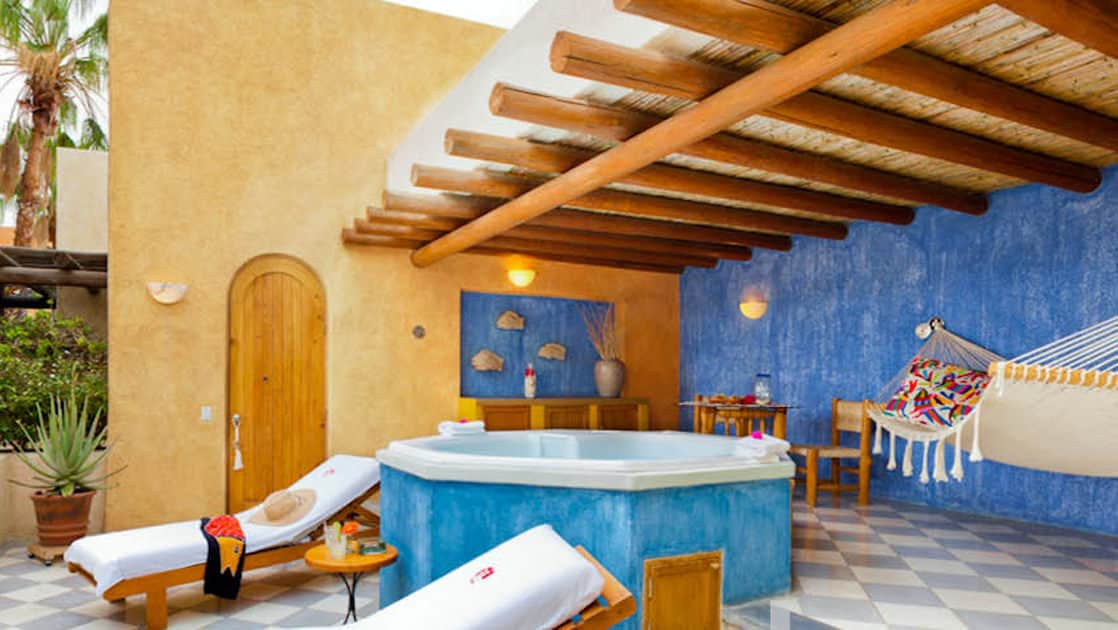 Private Jacuzzi tub with two lounge chairs, hammock and sitting area outside Spa Suite at Casa Natalia in San Jose del Cabo on the Baja Peninsula