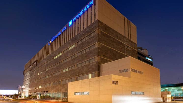 At night, lights illuminate Wyndham Costa del Sol hotel, connected to the Lima International Airport