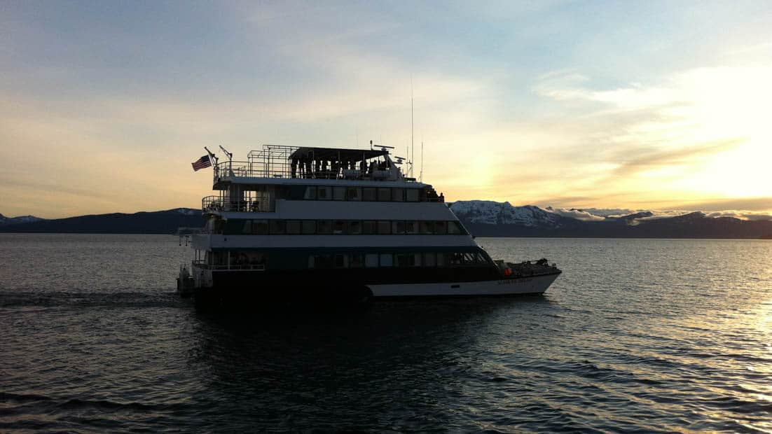 Starboard side of the Alaskan Dream cruising through the Alaskan waters during sunset.